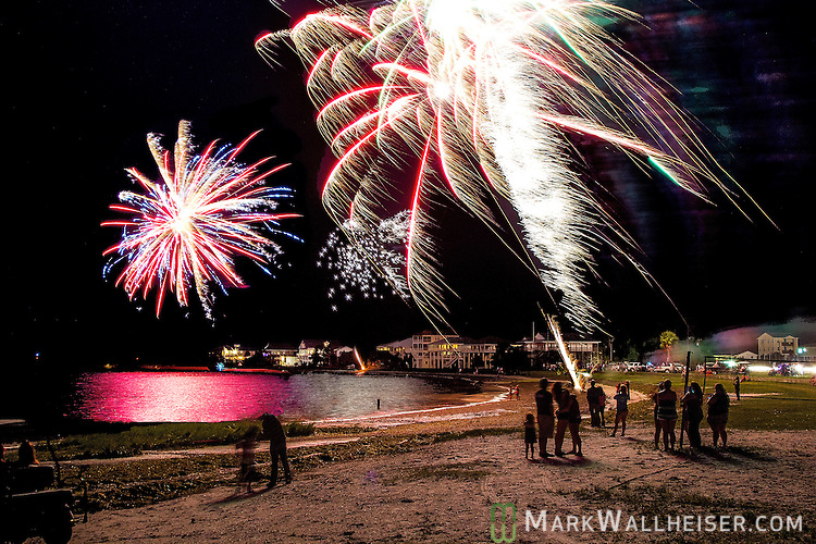 Residents watch the fireworks at Shell Point Beach in Wakulla County, Florida along the Forgotten Coast of the panhandle.