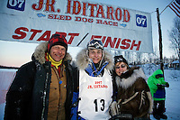 Sunday, February 25th, Willow, Alaska.  Jr. Iditarod musher Rohn Buser poses with his mom and dad at  the finish line after winning the 2007 Junior Iditarod