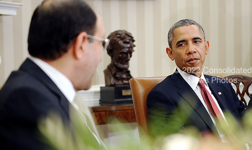 Prime Minister Nouri Al-Maliki of Iraq, left, meets with United States President Barack Obama, right, in the Oval Office at the White House November 1, 2013 in Washington, DC. <br /> Credit: Olivier Douliery / Pool via CNP