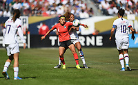 CHICAGO, IL - OCTOBER 06: Casey Short #26 of the United States battles for the ball against CHO SO-HYUN #8 of Korea Republic during their game versus Korea Republic at Soldier Field, on October 06, 2019 in Chicago, IL.