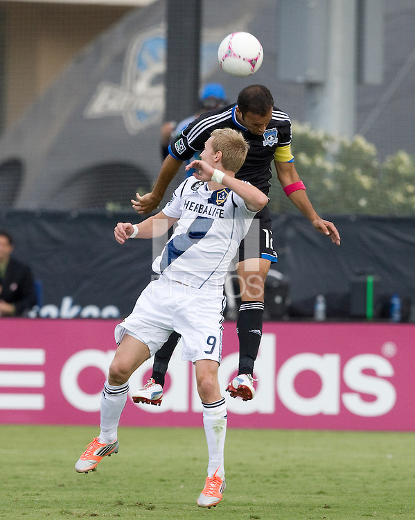 Ramiro Corrales of Earthquakes fights for the ball in the air against Christian Wilhelmsson of Galaxy during the game at Buck Shaw Stadium in Santa Clara, California on October 21st, 2012.  San Jose Earthquakes and Los Angeles Galaxy tied at 2-2.