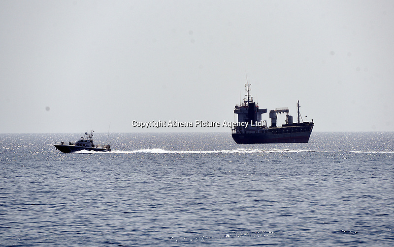 "Pictured: A Coastguard vessel (L) patrols the area near the oil spill that has reached the coast of Salamina, Greece<br /> Re: An oil spill off Salamina island's eastern coast is spreading and has become ""an environmental disaster"" according to local authorities in Greece.<br /> The spill was caused by the sinking of the Aghia Zoni II tanker, carrying 2,200 metric tons of fuel oil and 370 metric tons of marine gas oil on Saturday, southwest of the islet of Atalanti near Psytalleia. According to reports, the coastline stretching from Kinosoura to the Selinia community has ""turned black"" and authorities fear a new leak from the sunken ship.<br /> According to the island's mayor, Isidora Papathanasiou, the weather ""turned on Sunday afternoon and brought the oil spill to Salamina."""