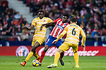 Thomas Teye Partey (C) of Atletico de Madrid fights for the ball with Michael Olunga Ogada (L) and Alex Granell Nogue of Girona FC during the La Liga 2017-18 match between Atletico de Madrid and Girona FC at Wanda Metropolitano on 20 January 2018 in Madrid, Spain. Photo by Diego Gonzalez / Power Sport Images