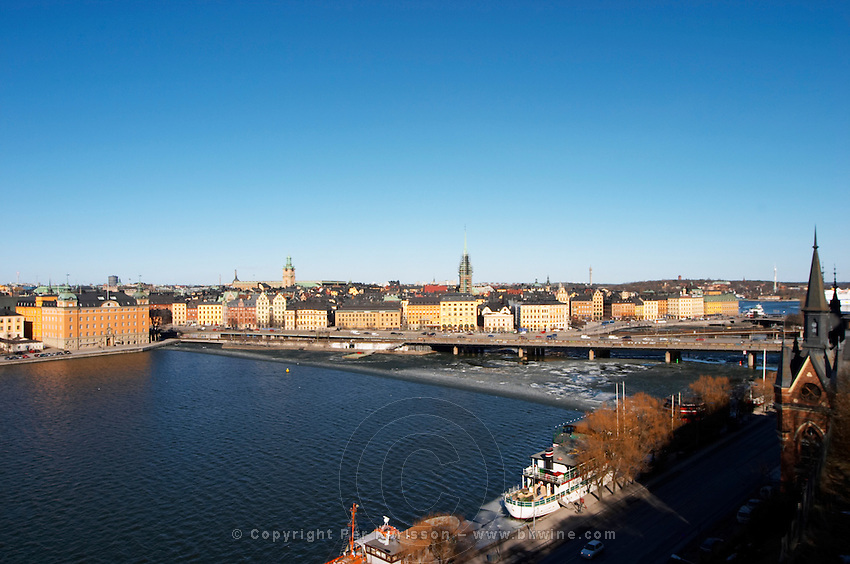 A view over Riddarfjarden water from left to right: Riddarholmen the Gamla Stan Old Town and the Centralbron bridge, the Soder key Stockholm, Sweden, Sverige, Europe