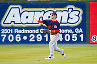 Center fielder Bryce Harper #34 of the Hagerstown Suns throws the ball back to the infield against the Rome Braves at State Mutual Stadium on April 30, 2011 in Rome, Georgia.   Photo by Brian Westerholt / Four Seam Images