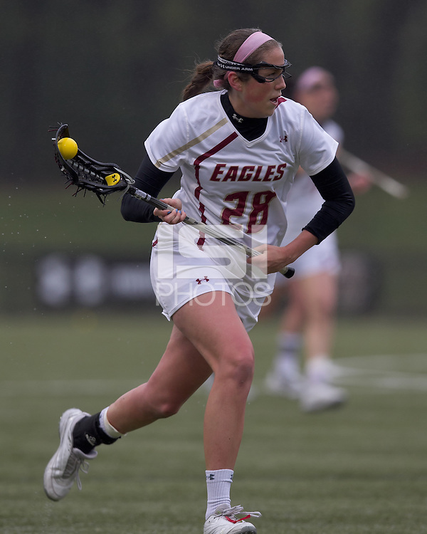 Boston College midfielder Katherine Caufield (28) brings the ball forward. Boston College defeated University of New Hampshire, 11-6, at Newton Campus Field, May 1, 2012.