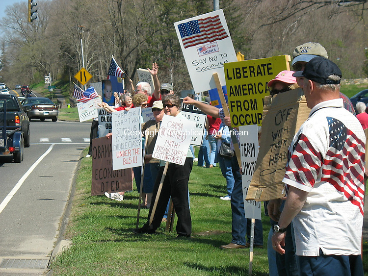 """WOODBURY, CT - 25 April 2009 - 42509RH01 - Anti-tax """"tea partiers"""" solicit approving honks from passing motorists at Washington Park at the corner of routes 64 and 6."""