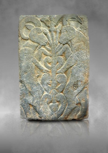 Pictures & images of the North Gate Hittite sculpture stele depicting Hittite mythical animal Gods. 8th century BC. Karatepe Aslantas Open-Air Museum (Karatepe-Aslantaş Açık Hava Müzesi), Osmaniye Province, Turkey. Against grey art background