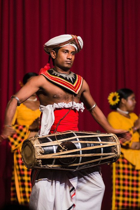 Kandy, photo of a man drumming at a traditional Kandyan dance tourist show at the Kandy Arts Assication Hall, Sri Lanka, Asia. This is a photo of a man drumming at a traditional Kandyan dance tourist show at the Kandy Arts Assication Hall, Sri Lanka, Asia.