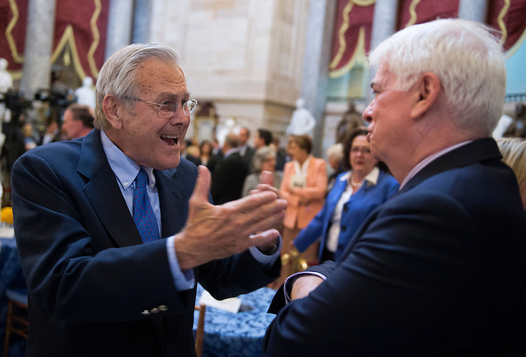 UNITED STATES - JUNE 13: Former Secretary of Defense Donald Rumsfeld, left, and former Sen. Chris Dodd, D-Conn., talk in the Capitol's Statuary Hall during a ceremony to honor Rep. John Dingell, D-Mich., as the longest serving member of Congress. Dingell came to Congress in 1955, filling his father's seat. (Photo By Tom Williams/CQ Roll Call)