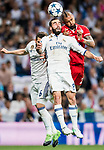 Daniel Carvajal Ramos (c) of Real Madrid battles for the ball with Arturo Vidal (r)  of FC Bayern Munich during their 2016-17 UEFA Champions League Quarter-finals second leg match between Real Madrid and FC Bayern Munich at the Estadio Santiago Bernabeu on 18 April 2017 in Madrid, Spain. Photo by Diego Gonzalez Souto / Power Sport Images