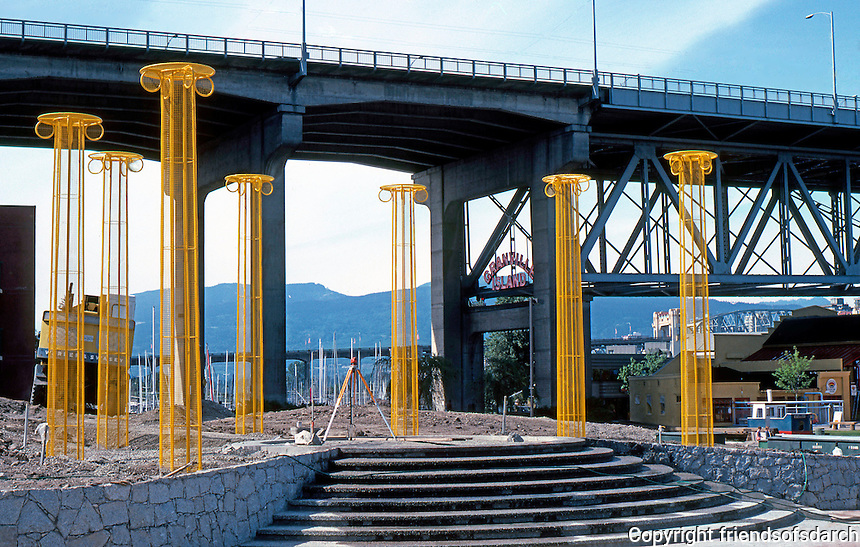 """Vancouver: """"Neo-Classical Columns"""", False Creek, 1986, at Sutcliffe Park by Ron Rule. 18 ft. high. Called """"hideous"""" by some residents. Photo '86."""