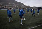 The home players taking part in their pre-match warm up before Cambrian and Clydach Vale take on Cwmbran Celtic at King George's New Field in a Welsh League Division One match, the top division of the Welsh Football League and the second level of the Welsh football league system. The club, formed in 1965 reached the final of the 2018-19 League Cup final and can count on ex-England manager Terry Venables as a former club chairman. Cambrian and Clydach Vale won this match 2-0, watch by a crowd of around 100 spectators.