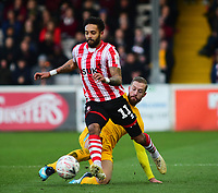 Lincoln City's Bruno Andrade is fouled by  Northampton Town's Kevin van Veen<br /> <br /> Photographer Andrew Vaughan/CameraSport<br /> <br /> Emirates FA Cup First Round - Lincoln City v Northampton Town - Saturday 10th November 2018 - Sincil Bank - Lincoln<br />  <br /> World Copyright &copy; 2018 CameraSport. All rights reserved. 43 Linden Ave. Countesthorpe. Leicester. England. LE8 5PG - Tel: +44 (0) 116 277 4147 - admin@camerasport.com - www.camerasport.com