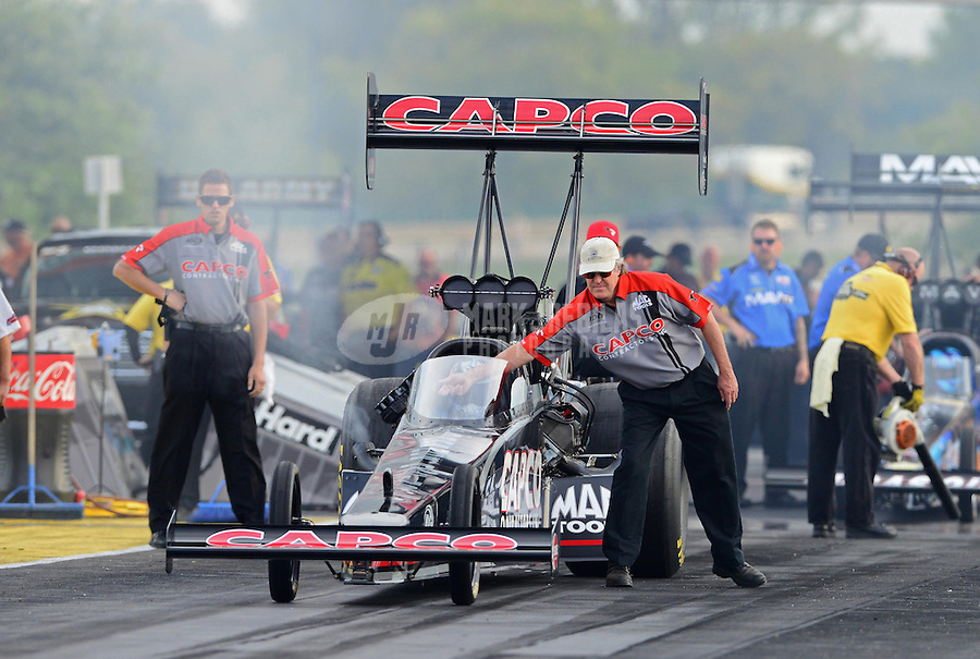 Sept. 28, 2012; Madison, IL, USA: NHRA crew members for top fuel dragster driver Steve Torrence during qualifying for the Midwest Nationals at Gateway Motorsports Park. Mandatory Credit: Mark J. Rebilas-