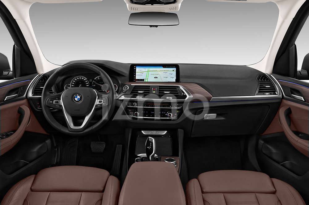 Stock photo of straight dashboard view of 2018 BMW X3 xLine-4wd 5 Door SUV Dashboard