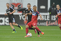 Washington, D.C.- March 29, 2014. Alex of the Chicago Fire goes against Perry Kitchen (23) of D.C. United.  The Chicago Fire tied D.C. United 2-2 during a Major League Soccer Match for the 2014 season at RFK Stadium.