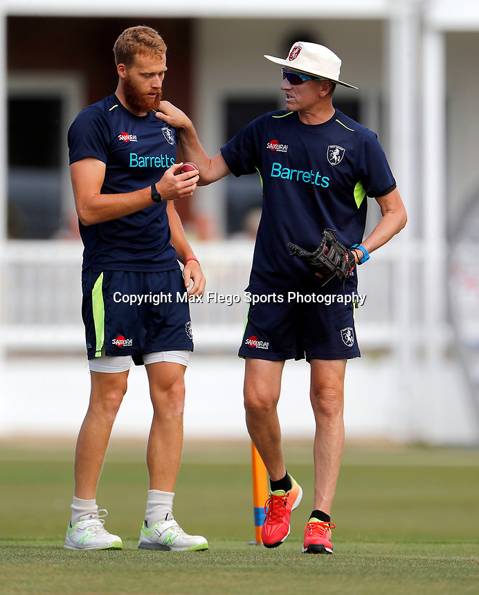 Assistant Kent coach Allan Donald (R) passes on some advice to Ivan Thomas during the County Championship Division 2 game between Kent and Leicestershire at the St Lawrence ground, Canterbury, on Sun July 22, 2018