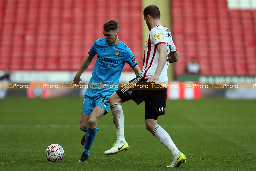 Jack Taylor of Barnet and Richard Stearman of Sheffield United during Sheffield United vs Barnet, Emirates FA Cup Football at Bramall Lane on 6th January 2019