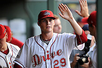Pitcher Jake Drehoff (29) of the Greenville Drive is congratulated after coming out of a game against the Charleston RiverDogs on Monday, June 29, 2015, at Fluor Field at the West End in Greenville, South Carolina. Greenville won, 4-2. (Tom Priddy/Four Seam Images)
