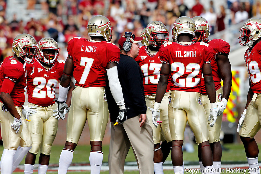 TALLAHASSEE, FL 10/29/11-FSU-NCST102911 CH-Florida State Defensive Coordinator Mark Stoops talks with his players during first half action against N. C. State Saturday at Doak Campbell Stadium in Tallahassee. .COLIN HACKLEY PHOTO