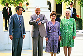 United States President George H.W. Bush says farewell to President Boris Yeltsin of the Russian Federation on the North Portico of the White House in Washington, DC  on June 18, 1992.  From left to right: President Bush, President Yeltsin, Naina Yeltsina, and first lady Barbara Bush.<br /> Credit: Ron Sachs / CNP
