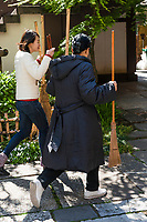 """""""Temple Morning"""" cleaning session. Komyoji Temple, Kamiyacho, Tokyo, Japan, April 13, 2019. Matsumoto Shoukei is the author of A Monk's Guide to a Clean House and Mind (Penguin). He hold periodic cleaning sessions at his temple in Tokyo's Kamiyacho district."""