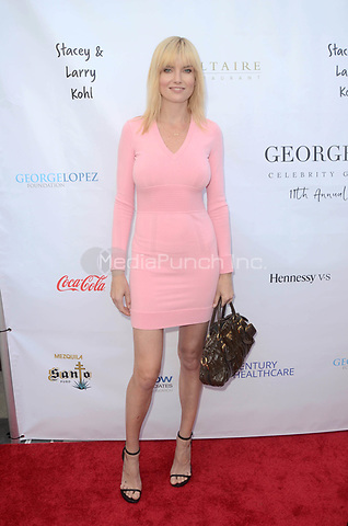 LOS ANGELES, CA - MAY 6: Eugenia Kuzmina at the 11th Annual George Lopez Foundation Celebrity Golf Classic Pre-Party, Baltaire Restaurant, Los Angeles, California on May 6, 2018. David Edwards/MediaPunch
