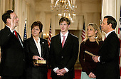 Washington, D.C. - February 1, 2006 -- Judge Samuel A. Alito is sworn-in as Associate Justice of the United States Supreme Court by Chief Justice John Roberts in Washington, D.C. on February 1, 2006 during a ceremony in the East Room of the White House hosted by United States President George W. Bush.  From left to right: Samuel Alito, wife, Martha-Ann Alito, son Phil Alito, daughter Laura Alito, and Chief Justice Roberts. .Credit: Ron Sachs / CNP