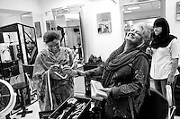 Depilex founder, Massarat Misbah (C) shares a joke with her employees before the beginning of their shift at a Depilex beauty salon in Lahore, Pakistan.