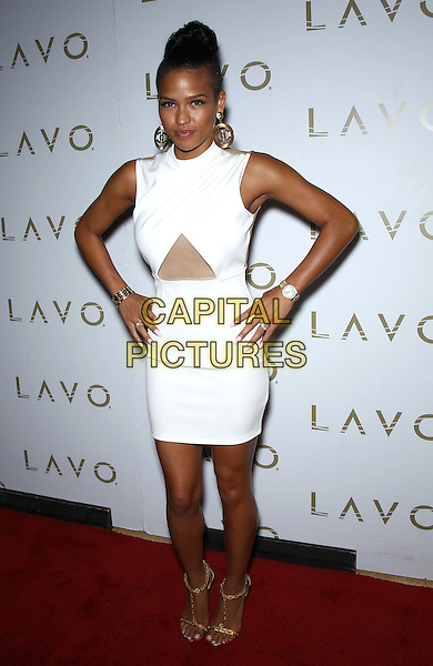 Cassie (Casandra Elizabeth Ventura) .hosts King of Hearts party at Lavo inside The Palazzo Las Vegas, Nevada, USA, 14th July 2012..full length white dress cut out mesh sleeveless  gold sandals hands on hips .CAP/ADM/MJT.© MJT/AdMedia/Capital Pictures.