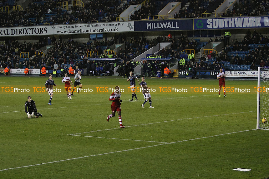 Albert Adomah of Middlesbrough rounds keeper David Forde of Millwall to score second goa - Millwall vs Middlesbrough - Sky Bet Championship Football at the New Den, Bermondsey, London - 21/12/13 - MANDATORY CREDIT: George Phillipou/TGSPHOTO - Self billing applies where appropriate - 0845 094 6026 - contact@tgsphoto.co.uk - NO UNPAID USE