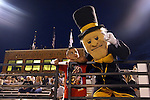 05 September 2014: Wake Forest Demon Deacon mascot with a young fan. The Wake Forest University Demon Deacons hosted the University of Connecticut Huskies at W. Dennie Spry Soccer Stadium in Winston-Salem, North Carolina in a 2014 NCAA Division I Men's Soccer match. Wake Forest won the game 2-1 in sudden death overtime.