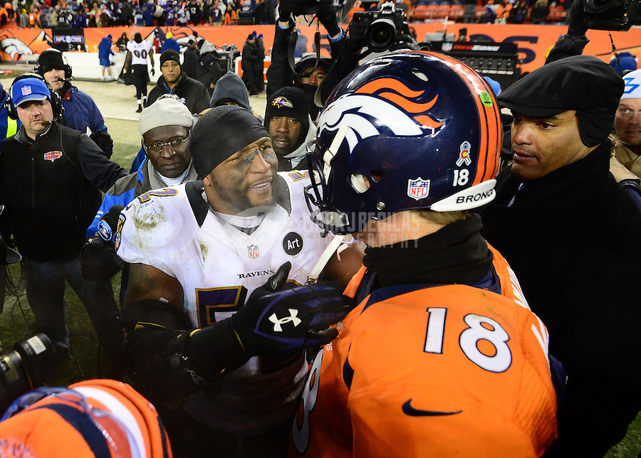 Jan 12, 2013; Denver, CO, USA; Baltimore Ravens linebacker Ray Lewis (52) is congratulated by Denver Broncos quarterback Peyton Manning following the AFC divisional round playoff game at Sports Authority Field.  The Ravens defeated the Broncos 38-35 in double overtime. Mandatory Credit: Mark J. Rebilas-