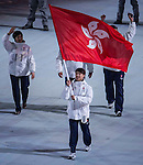 Short track speed skater Pan-To Barton Lui of Hong Kong carries his country's flag during the Opening Ceremony of the 2014 Sochi Olympic Winter Games at Fisht Olympic Stadium on February 7, 2014 in Sochi, Russia. Photo by Victor Fraile / Power Sport Images