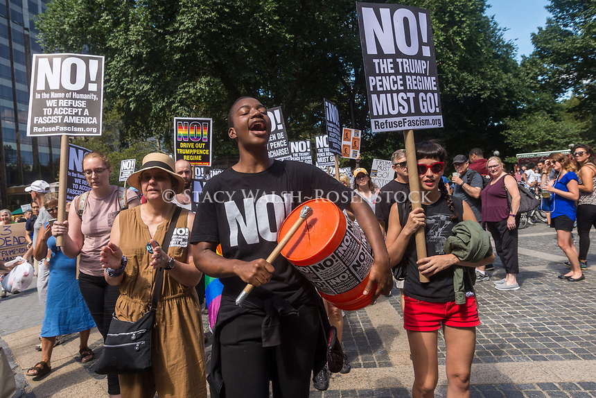 New York, NY 13 August 2017 - Fire & Fury - Anti - trump protesters gathered in Columbus Circle, across from Trump Hotel And Towers, to speakout against President Trump's threats against North Korea and remember those killed in Charlottesville, VA. ©Stacy Walsh Rosenstock