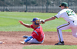 Reno's Riley Smith is tagged out by Manogue's Jack Weise in the NIAA 4A Northern Regional Baseball Championship at Galena High School in Reno, Nevada on Saturday, May 12, 2018.