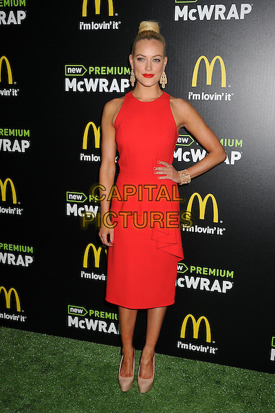Peta Murgatroyd.McDonald's Premium McWrap Launch Party held at Paramount Studios, Los Angeles, California, USA..March 28th, 2013.full length red sleeveless dress hand on hip hair up bun peplum beige shoes .CAP/ADM/BP.©Byron Purvis/AdMedia/Capital Pictures.
