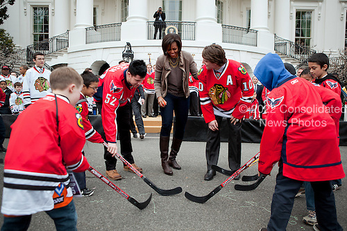 """First Lady Michelle Obama participates in a """"Let's Move!"""" and NHL partnership event with Chicago Blackhawks and Washington Capitals players on the South Lawn of the White House, March 11, 2011.  .Mandatory Credit: Samantha Appleton - White House via CNP"""
