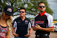 Apr 22, 2017; Baytown, TX, USA; NHRA top fuel driver Leah Pritchett (left) with Papa John's pizza founder John Schnatter (center) and husband Gary Pritchett during qualifying for the Springnationals at Royal Purple Raceway. Mandatory Credit: Mark J. Rebilas-USA TODAY Sports