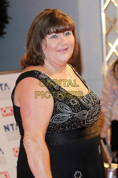 CHERYL FERGISON .At the National Television Awards, held at O2 Arena, London, England, UK, January 20th 2010..arrivals TV NTA NTAs half length black sleevelses dress beaded fringe smiling  .CAP/FIN.©Steve Finn/Capital Pictures.