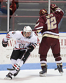 Mike McLaughlin (NU - 18), Ben Smith (BC - 12) - The Northeastern University Huskies defeated the Boston College Eagles 3-2 on Friday, February 19, 2010, at Matthews Arena in Boston, Massachusetts.
