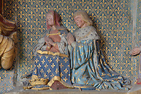 King Charles V, 1500-58, and his wife Isabella of Portugal, kneeling in prayer, polychrome stone in high relief, 1511, restored 1888-95, from the South East wall of the Chapel of Our Lady of the Assumption in the Collegiate Church of Saint-Gervais-Saint-Protais, built 12th to 16th centuries in Gothic and Renaissance styles, in Gisors, Eure, Haute-Normandie, France. The church was consecrated in 1119 by Calixtus II but the nave was rebuilt from 1160 after a fire. The church was listed as a historic monument in 1840. Picture by Manuel Cohen