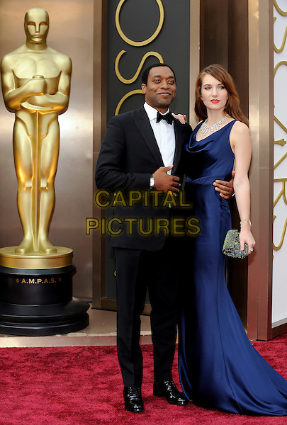 HOLLYWOOD, CA - MARCH 2: Chiwetel Ejiofor, Sari Mercer  arriving to the 2014 Oscars at the Hollywood and Highland Center in Hollywood, California. March 2, 2014. <br /> CAP/MPI/COR99<br /> &copy;COR99/MediaPunch/Capital Pictures