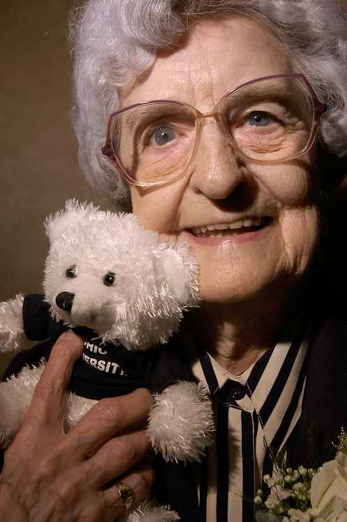 16423International Association of Administrative Professionals Angie Woodyard: Johnny Hanson..Ruth Ellen Story, CPS, founding member of the International Association of Administrative Professionals Athens Chapter in 1955, posing with a teddy  bear she won during a raffle at the awards ceromony at Ohio University.