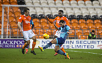 Sam Wood of Wycombe Wanderers under pressure from Bright Osayi-Samuel & Danny Pugh (left) of Blackpool during the The Checkatrade Trophy match between Blackpool and Wycombe Wanderers at Bloomfield Road, Blackpool, England on 10 January 2017. Photo by Andy Rowland / PRiME Media Images.
