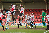 Harry Pell of Cheltenham Town clears a corner during the Sky Bet League 2 match between Cheltenham Town and Grimsby Town at the The LCI Rail Stadium,  Cheltenham, England on 17 April 2017. Photo by PRiME Media Images / Mark Hawkins.