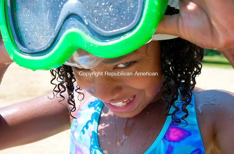 WATERBURY, CT. 26 June 2007-062607SV03--Erica Rountree, 8, of Waterbury gets ready to go underwater while swimming at Lakewood Park in Waterbury Tuesday. Area temperatures were well into the 90's and humid.<br /> Steven Valenti Republican-American