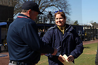 DURHAM, NC - FEBRUARY 29: Head coach Deanna Gumpf of the University of Notre Dame meets with the umpire during a game between Notre Dame and Duke at Duke Softball Stadium on February 29, 2020 in Durham, North Carolina.
