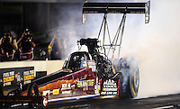 Sept. 17, 2010; Concord, NC, USA; NHRA top fuel dragster driver David Grubnic does a burnout during qualifying for the O'Reilly Auto Parts NHRA Nationals at zMax Dragway. Mandatory Credit: Mark J. Rebilas/